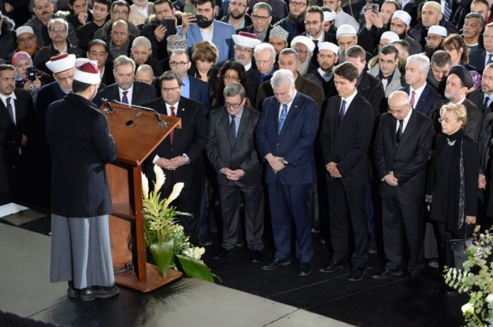 Right to Left: Justin Trudeau, Canadian Prime Minister, Quebec Premier Phillippe Couillard, Regis Labeaume, Mayor of Quebec City, and Denis Coderre, Mayor of Montreal attend the janaza for three of the Quebec Islamic Center victims along with thousands of others at the Maurice Richard Arena in Montreal. (Photo via the Toronto Star)