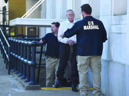 Robert Doggart, convicted on four criminal counts, is led to jail by federal marshals after his trial in Chattanooga, Tennessee. / Photo by Tim Barber/Times Free Press