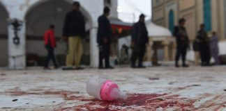 A child's bottle forms part of the bloody debris at the shrine of Lal Shahbaz Qalandar.