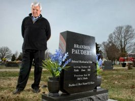 Bob Paudert visits the grave of his son, Sgt. Brandon Paudert, who was gunned down along with another officer in 2010 by a father and son who had been crisscrossing the country preaching about the sovereign citizen movement. Photo by Keith Myers, the Kansas City Star