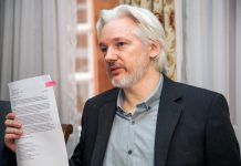 Wikileaks founder Julian Assange during a press conference in the Ecuador embassy, London, 2014. via Cancilleria del Ecuador