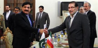 Secretary of Iran's Supreme National Security Council Ali Shamkhani (R) shakes hands with Adviser to Pakistani Prime Minister on National Security Naseer Khan Janjua in Tehran on July 25, 2016. IRNA