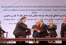Iran signed a multibillion dollar deal with French oil giant Total and Chinese state oil company CNPC to further develop the country's giant South Pars Gas Field in cooperation with Iran's Petropars..jpg