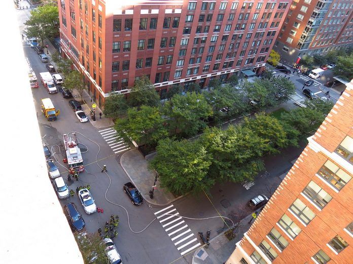The scene of the 2017 New York City attack approximately an hour after the attack itself happened. The damaged school bus which the attacker's truck crashed into can be seen on the top left. This photo was taken from the 10th floor of Stuyvesant High School. (GH9449/Wikimedia photo)