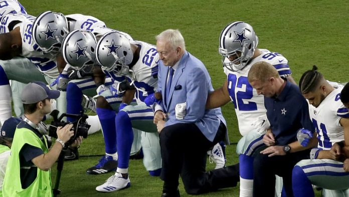 Jerry Jones, Dallas Cowboys owner, takes a knee with the team during the game against the Arizona Cardinals to show support for ending racism, police brutality and injustice. (NPR photo)